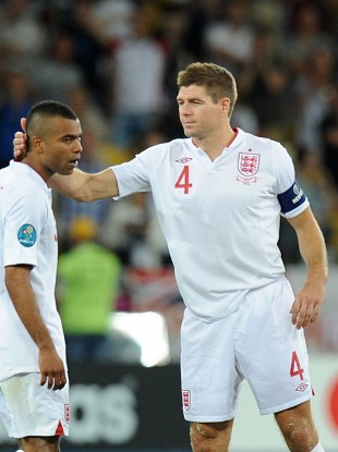 Gerrard consoles Ashley Cole after his penalty miss. 