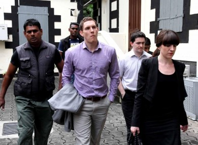 John McAreavey with his sister Claire (right) and Mark Harte (second right), brother of Michaela, pictured at the court in Mauritius today