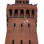 Torchbearer Alan Ellinson abseils with the Olympic Flame down the side of the Royal Dock Tower in Grimsby at the beginning of Day 40 of the London 2012 Olympic Torch Relay. (Gareth Fuller/LOCOG/PA Images)