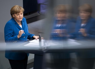 Angela Merkel addresses the Bundestag ahead of the two-day summit in Brussels.