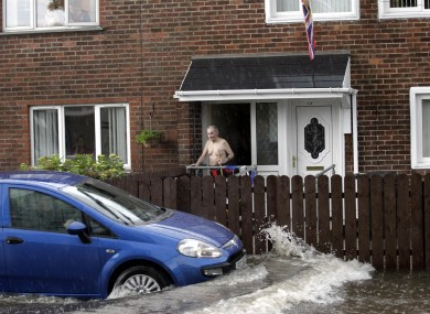 A motorists in the Cregagh area of East Belfast struggles to get through the flash floods.
