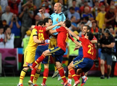 Spain's Francesc Fabregas (second left) celebrates with team-mates after scoring his penalty to send his team through to the final.