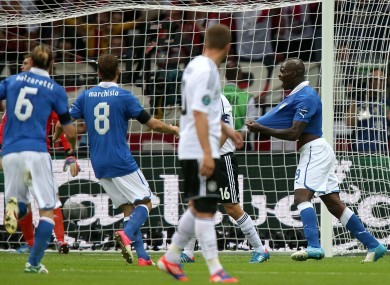 Italy celebrate as the dejected Germans look on