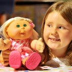 Katrie Palmer, eight, looks at the latest version of the Cabbage Patch Kids