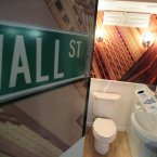A Wall Street themed bathroom, complete with an electronic ticker read-out in Times Square in New York (AP Photo/Seth Wenig)