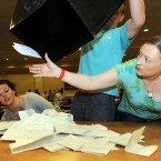 Aoife Sheridan (right) grabs a stray vote as boxes are unopened as the count of the Campaign for the European Fiscal Stability Treaty Referendum begins at the Dublin City count centre in CityWest. (Laura Hutton/Photocall Ireland)