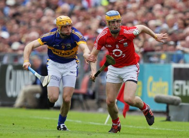 Cork's Darren Sweetman and Shane McGrath of Tipperary battle for possession.
