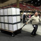 Electoral workers arrive with ballot boxes to be counted at the City West Hotel, Dublin. (AP Photo/Peter Morrison)