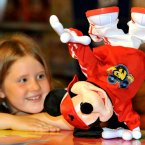 Katrie Palmer, eight, looks at a break-dancing Mickey Mouse, at Hamleys in central London