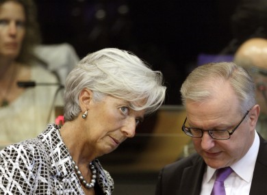 Managing Director of the International Monetary Fund Christine Lagarde, left, speaks with European Commissioner for the Economy Olli Rehn