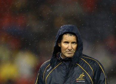 Wallabies coach Robbie Deans watches players warm up before the game with Scotland this week.