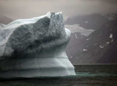 A melting iceberg floats away from Greenland's ice sheet near Nuuk.