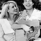 Mick Jagger with his fiancee Jerry Hall at Gibbs Beach, St. Peter, Barbados on December 5, 1983. (AP Photo/Paul R. Benoit)
