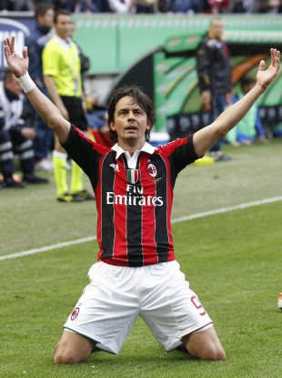 AC Milan forward Filippo Inzaghi celebrates after scoring during a Serie A clash against Novara.