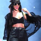 Rihanna in her signature shorts and crop top on stage earlier this year.