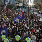 Protesters carry Hong Kong colonial flags (AP Photo/Vincent Yu)