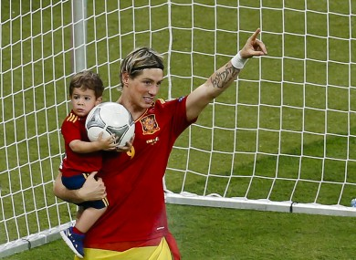 Torres with his son Leo after the final whistle last night.
