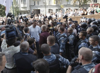 Klitschko, centre, talks to riot police at the opposition protest rally.