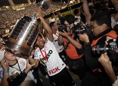 Corinthians' Romarinho, second from left, lifts the trophy at the end of the Copa Libertadores final.
