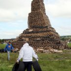 Men carry tyres to one of the biggest 11 July bonfires at New Mossley on the outskirts of Belfast. (Photo:Paul Faith/PA Wire)