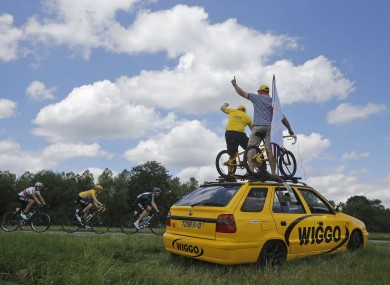 Supporters of Bradley Wiggins cheer on the yellow jersey holder yesterday.