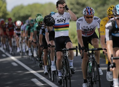 Mark Cavendish of Britain adjusts his helmet as he rides in the pack during the 10th stage.