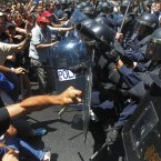 Demonstrators clash with riot police during the coal miner's march to the Minister of Industry's building in Madrid, Wednesday, July 11, 2012. (AP Photo/Andres Kudacki)