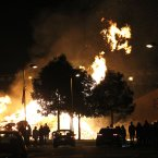 Protestants watch a bonfire in the Shankill Estate (AP Photo/Peter Morrison)