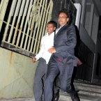 Ravi Rutnah holds the hand of Avinash Treebhoowoon after the verdict