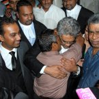 Sandip Mooneea (centre front) embraces Rama Valayden after he was acquitted