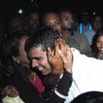 Reshma Treebhoowoon (partially obscured) embraces her husband Avinash Treebhoowoon