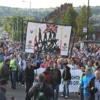 Nationalists hold a counter demonstration in the Catholic Ardoyne area of Belfast a short time after a token group of Orange marchers passed by