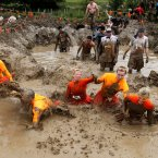 Participant tackle the Mud Mile obstacle during the 2012 Tough Mudder Extreme Endurance Challenge held in the grounds of Drumlanrig Castle and Country Estate in Dumfriesshire.