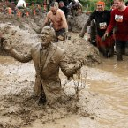 Keegan Rannoch in a mud covered suit in the Mud Mile obstacle as he takes part in the 2012 Tough Mudder Extreme Endurance Challenge held in the grounds of Drumlanrig Castle and Country Estate in Dumfriesshire.
