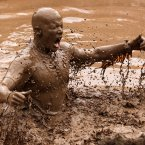 A participant tackles the Mud Mile obstacle during the 2012 Tough Mudder Extreme Endurance Challenge held in the grounds of Drumlanrig Castle and Country Estate in Dumfriesshire.