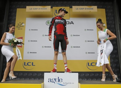 Tejay van Garderen of the US waits to recieve the best young rider's white jersey on the podium of the 13th stage.