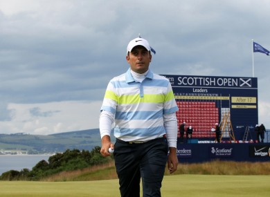 Italy's Francesco Molinari walks off the eighteenth as overnight leader during day three of the Scottish Open.