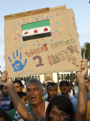 A Syrian expatriate family shouts as a girl holds a banner during a protest in solidarity with the Syrian people, in Casablanca, Morocco yesterday
