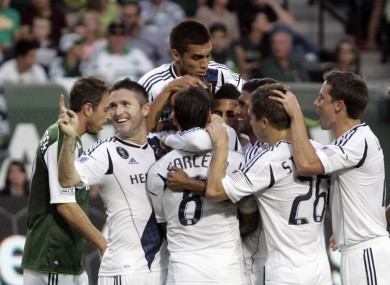 The Galaxy players mob Beckham after his second goal.