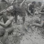 Tourists play with the mud during the Boryeong Mud Festival on Daecheon Beach in Boryeong, South Korea. The 15th annual mud festival features mud wrestling, mud sliding and a mud king contest. (AP Photo/Ahn Young-joon)