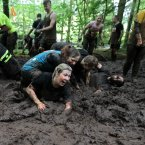 Participants struggle in the mud on the final day of the 2012 Tough Mudder Extreme Endurance Challenge held in the grounds of Drumlanrig Castle and Country Estate in Dumfriesshire.