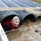 A participant tackles the Boa Constrictor on the final day of the 2012 Tough Mudder Extreme Endurance Challenge held in the grounds of Drumlanrig Castle and Country Estate in Dumfriesshire.