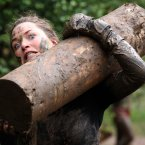 A participant tackles the Hold Your Wood obstacle on the final day of the 2012 Tough Mudder Extreme Endurance Challenge held in the grounds of Drumlanrig Castle and Country Estate in Dumfriesshire.
