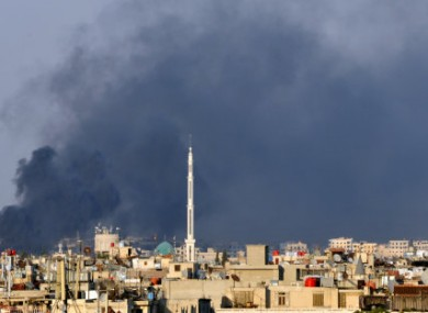 Smoke billowing over Damascus last week.