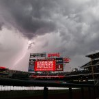 A lightning bolt comes down from the clouds near Nationals Park before a baseball game between the Washington Nationals and the New York Mets. (AP Photo/Alex Brandon)