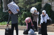 Thousands flee Syria as war rages on