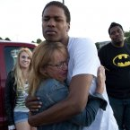 Judy Goos, second from left, hugs her daughter's friend, Isaiah Bow, 20, while eye witnesses Emma Goos, 19, left, and Terrell Wallin, 20, right, gather outside Gateway High School'. (AP Photo/Barry Gutierrez)