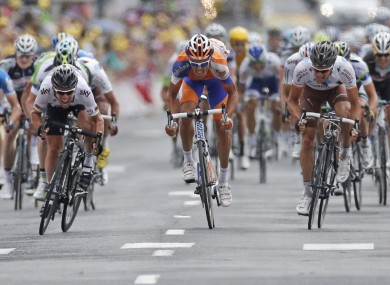 Cavendish, left, sprints past Luis-Leon Sanchez yesterday.