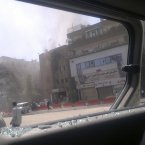 This citizen journalist image shot through a broken car window shows smoke billowing from a building after fighting between rebels and Syrian troops in the Yarmouk camp for Palestinian refugees in south Damascus, Syria, Saturday, July 21, 2012. (AP Photo)