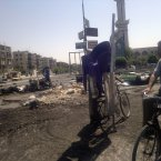 Activists and residents reported a tense calm in Damascus Saturday but said sporadic gunfire and explosions could be heard throughout the night. (AP Photo)